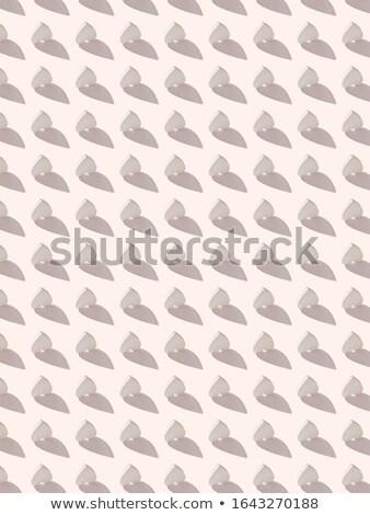 Festive pattern from gypsum hearts with hard shadows. Stock photo © artjazz