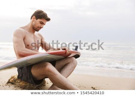 ハンサム 若い男 リラックス ビーチ サーフボード 男 ストックフォト © deandrobot