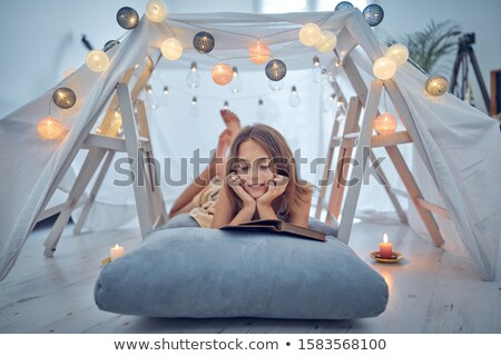 little girl with lantern in kids tent at home Stock photo © dolgachov