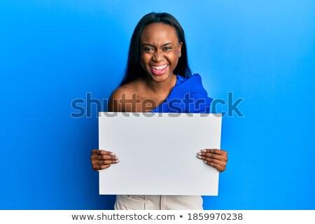Kép vicces afroamerikai nő tart plakát Stock fotó © deandrobot