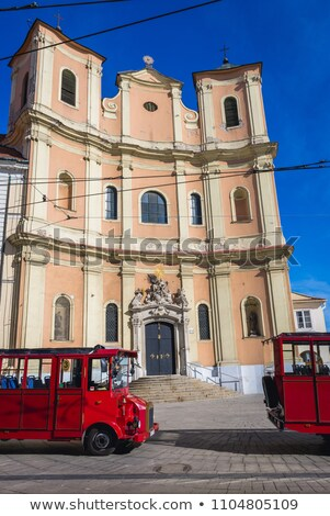 tourist train in front of trinity church bratislava slovakia stock photo © phbcz