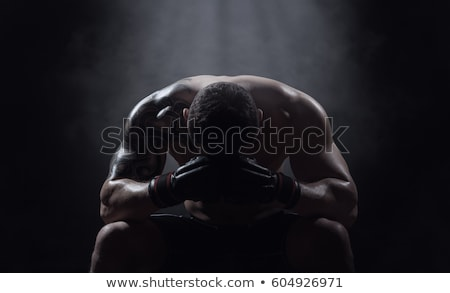 Fighter on black background stock photo © pedromonteiro