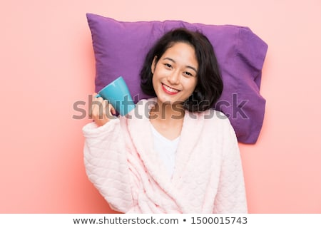 happy young woman with coffee in pajamas stock photo © candyboxphoto