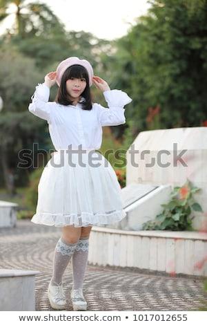 sweet japanese lolita phoning stock photo © smithore
