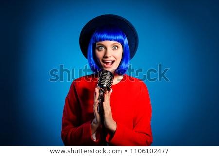 Stock photo: Trendy Singer Girl Singing In Retro Mic