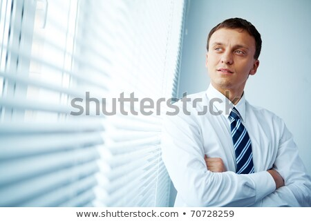 successful businessman on telephone stock photo © lovleah