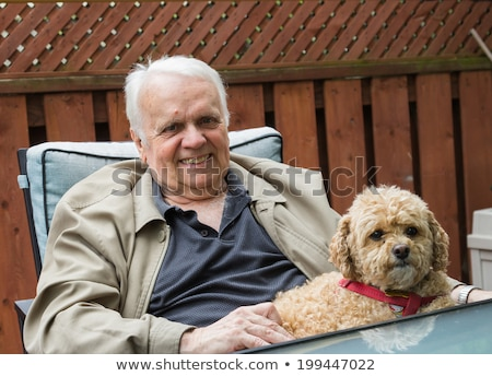 Elderly man relaxing in his garden Stock photo © photography33