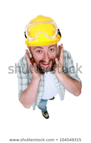 Goofy tradesman putting his hands along his face Stock photo © photography33