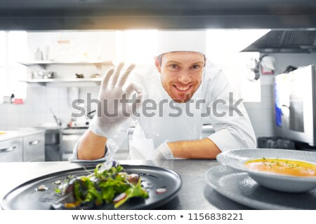young chief cook showing a salad dish Stock photo © photography33