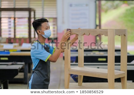 Tradesman using a sander Stock photo © photography33