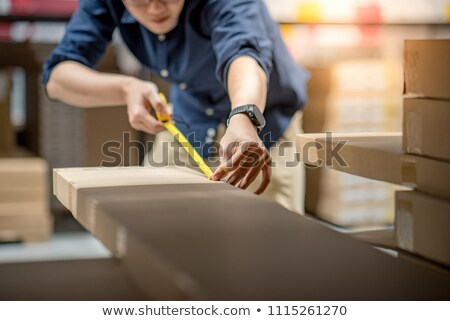 Homem fita métrica parede lápis trabalhador Foto stock © photography33
