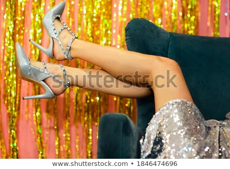 Luxury legs on golden background with blurred lights Stock photo © Nobilior