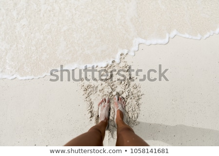 sandy feet on the beautiful beach Stock photo © H2O