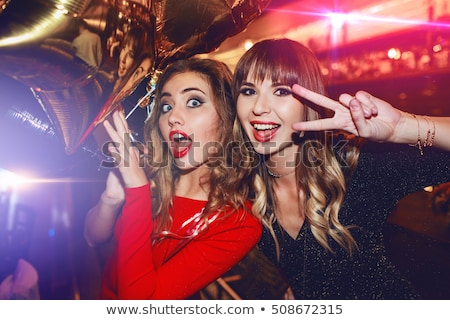 two young women in evening dress stock photo © acidgrey