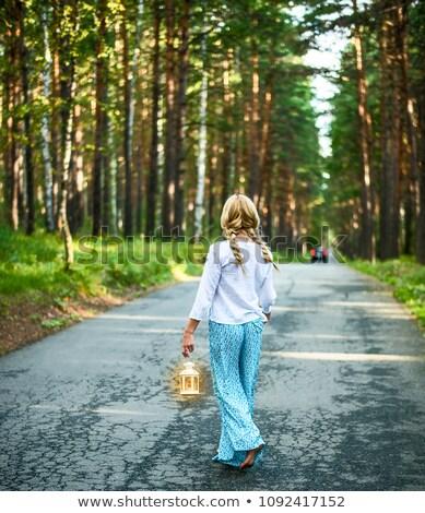 young blonde stands on asphalt road stock photo © acidgrey