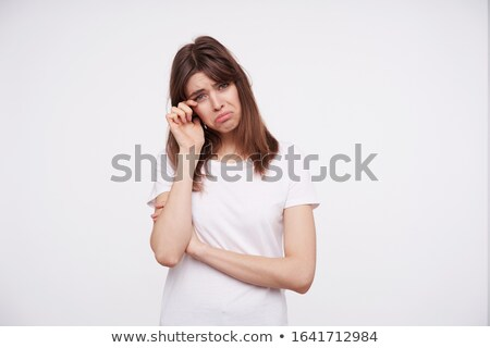 Portrait bouleversé femme posant permanent blanche Photo stock © wavebreak_media