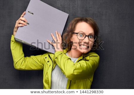 Portrait of a businesswoman punching someone against a white background Stock photo © wavebreak_media