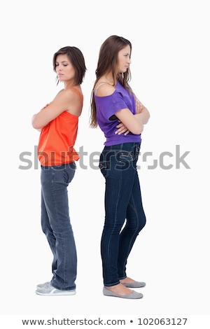 Teenagers standing back to back and crossing their arms Stock photo © wavebreak_media