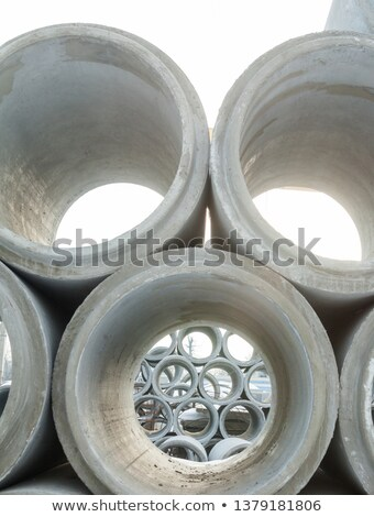 stack of many concrete drainage pipe stock photo © stoonn