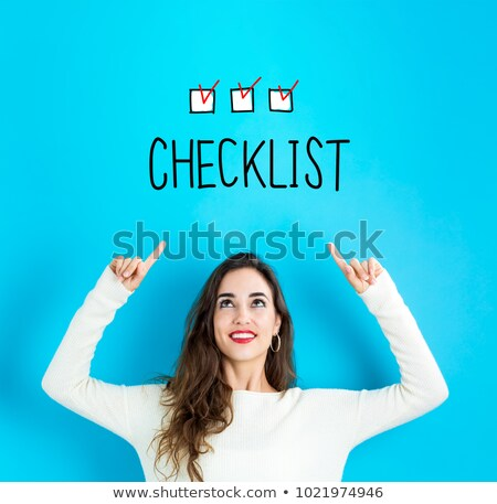 Smiling young woman with the palm upward Stock photo © pablocalvog
