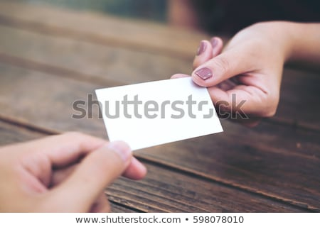 woman handing a blank business card stock photo © vwalakte