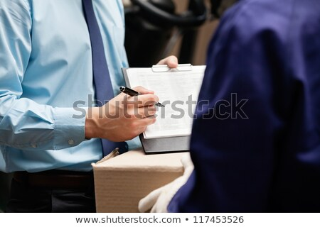 Supervisor holding clipboard Stock photo © photography33