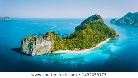 Légifelvétel idilli trópusi sziget kora reggel tenger csónak Stock fotó © moses