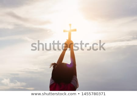 Holding a Religious Cross Stock photo © kbuntu