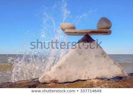 A drop of water drips on the pyramid stone Stock photo © alekleks