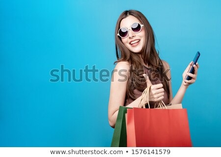 Surprised lady with shopping bag stock photo © stockyimages