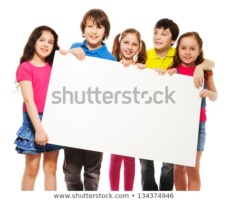 smiling teen girls with blank sign stock photo © elvinstar