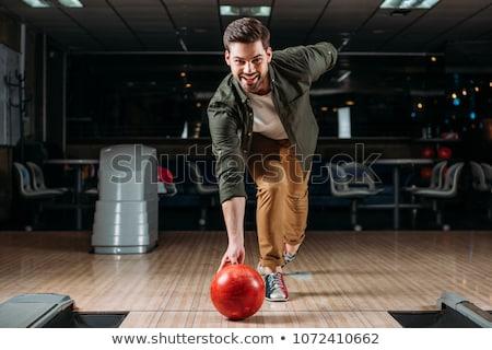 Fiatalember bowling sport férfiak jókedv labda Stock fotó © Jasminko