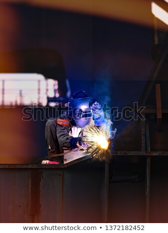 worker cutting steel and spark Stock photo © FrameAngel