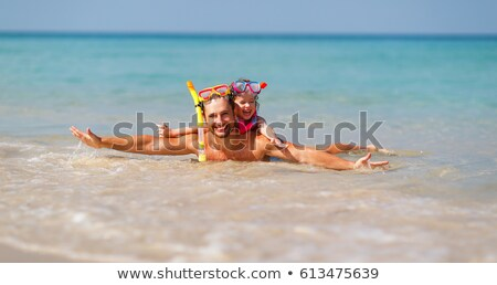 Stock photo: father and daughter on beach in scuba mask