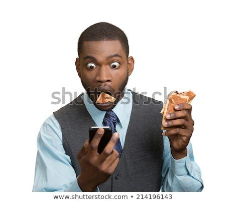 üzletember rendkívüli hírek fiatal ül asztal olvas Stock fotó © feedough