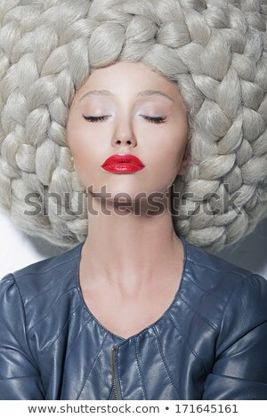 Classy Glamorous Blonde with Waved and Frizzy Hair Stock photo © gromovataya