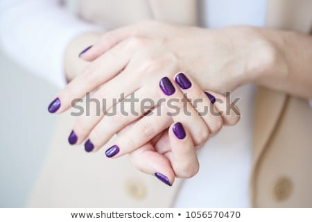 Woman with beautiful manicured purple nails Stock photo © juniart