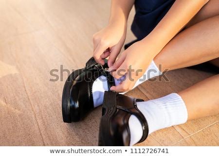 Femme noir chaussures blanche femmes mode Photo stock © cypher0x