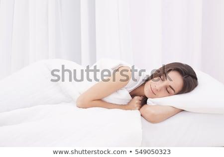 Belo mulher jovem cama enrolado meias Foto stock © dash