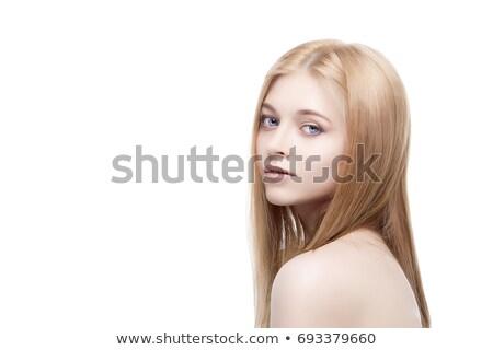 młoda · kobieta · uśmiechnięty · patrząc · w · górę - zdjęcia stock © stockyimages