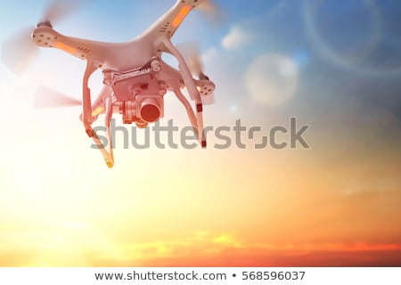 quadrocopter drone flying in the sky stock photo © kor