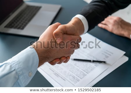 Businessman signing contract Stock photo © HASLOO