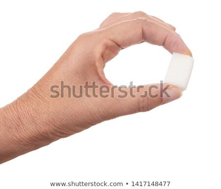 White sugar cube held between fingers Stock photo © erierika