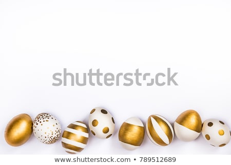 easter egg of gold stripes on white background stock photo © oneo