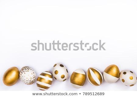 Stock photo: Easter egg of gold stripes on white background