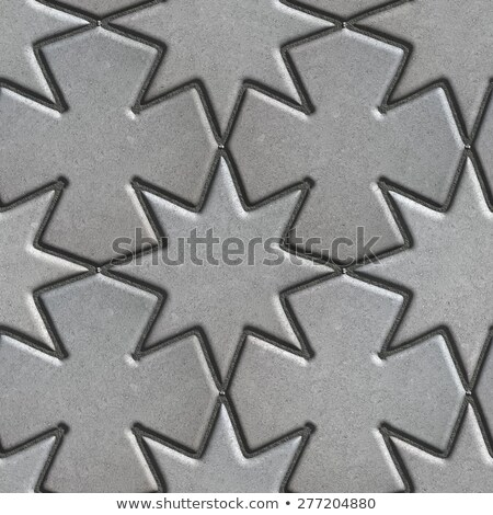 Gray Paving Slabs Laid in the Form of Stars and Crosses. Stock photo © tashatuvango
