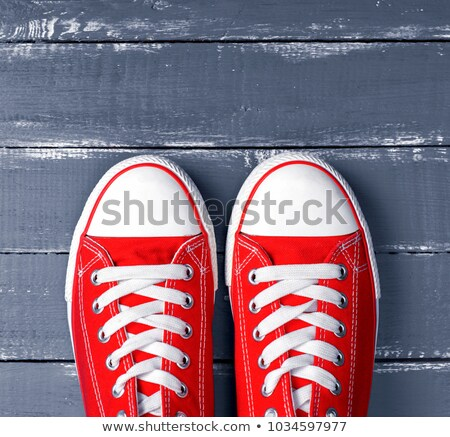 Feet From Above, Teenager in Sneakers Standing on Blue Backgroun Stock photo © stevanovicigor