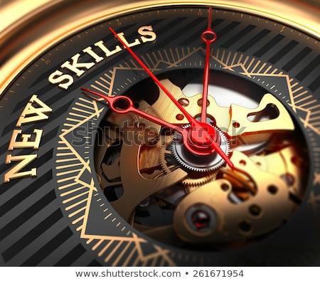 new skills on black golden watch face stock photo © tashatuvango