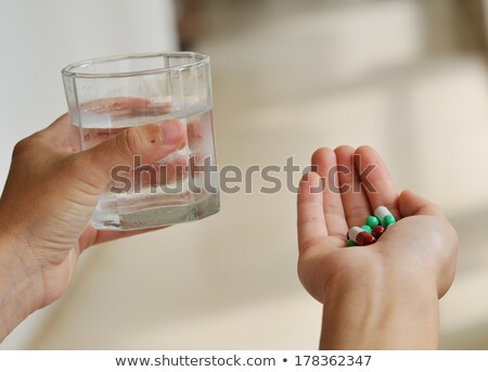 Mid section of man holding vitamin pills in hand Stock photo © wavebreak_media