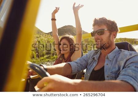 Conduzir carro casal feminino sorridente Foto stock © wavebreak_media